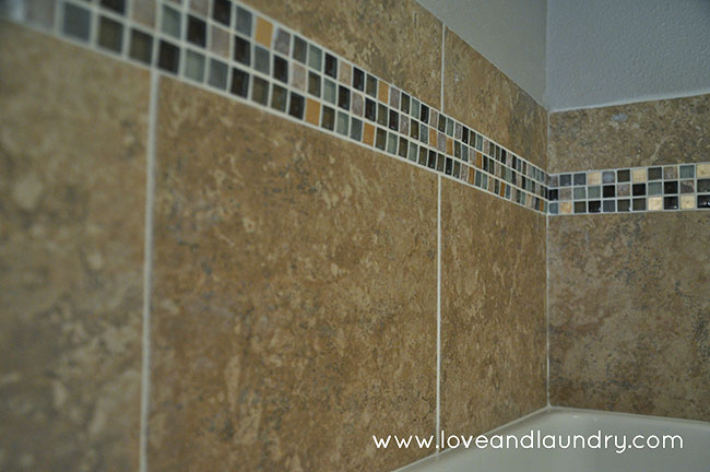If you have tub/shower surround, this tile project is a quick and easy update to not only protect your walls, but make your shower look more beautiful!
